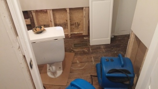 Bathroom aftermath - all tile and lots of drywall removed